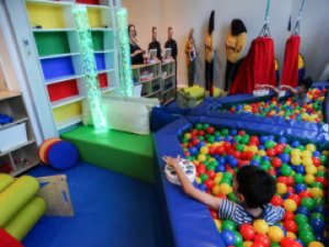 sensory room ball pit with boy playing