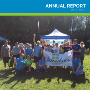 annual report cover, group picture of woodview staff