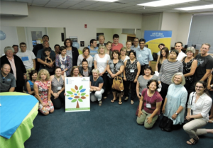 Group poses at LIFE program open house celebration