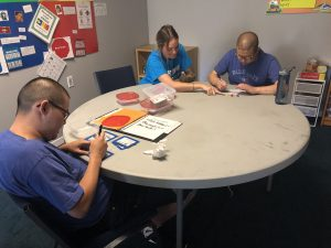 autism counsellor helps client with math work