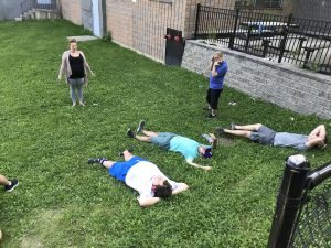 group lying on the grass meditating