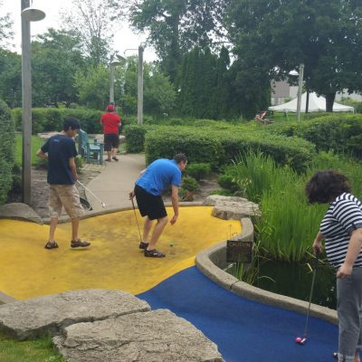youth group playing mini golf