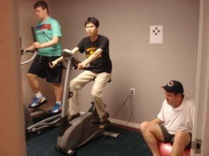 three youth exercising in gym
