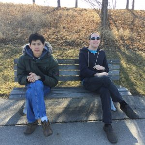 two youth sitting on bench